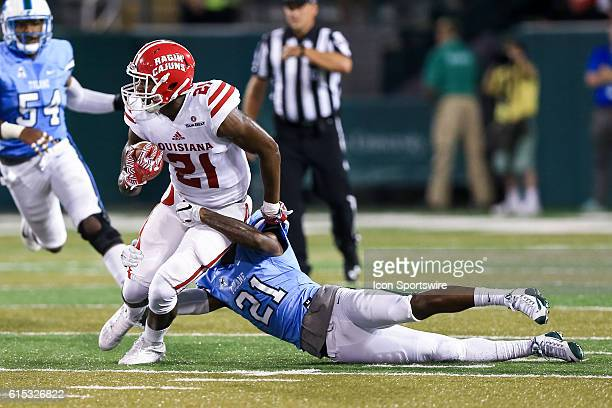 LouisianaLafayette Ragin Cajuns wide receiver CJ Bates is tackled by Tulane Green Wave cornerback Donnie Lewis Jr during the first half of the game...