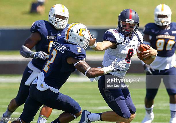 Samford Bulldogs quarterback Devlin Hodges throws a stiff arm at Chattanooga Mocs defensive back Cedric Nettles during the game between Samford and...