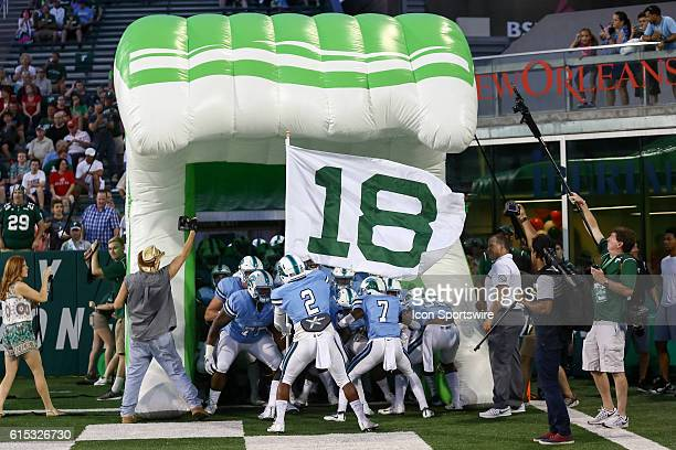 Tulane Green Wave linebacker Nico Marley waves a flag for former Tulane player Devon Walker during the first half of the game between the Tulane and...