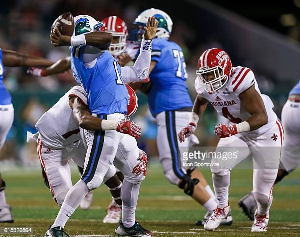 Tulane Green Wave quarterback Glen Cuiellette is sacked by LouisianaLafayette Ragin Cajuns linebacker Tre'maine Lightfoot during the first half of...