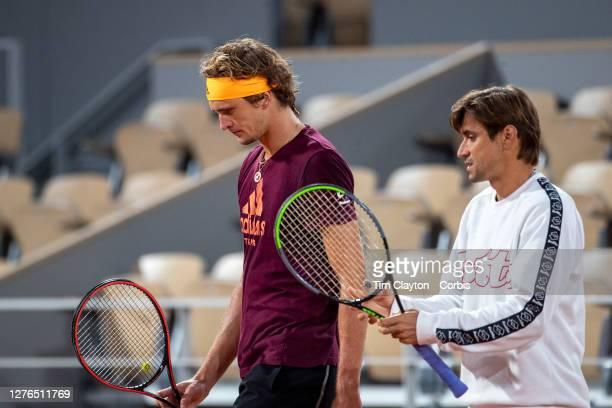 September 24. Alexander Zverev of German with coach David Ferrer during a practice match with Rafael Nadal of Spain on Court Philippe-Chatrier in...