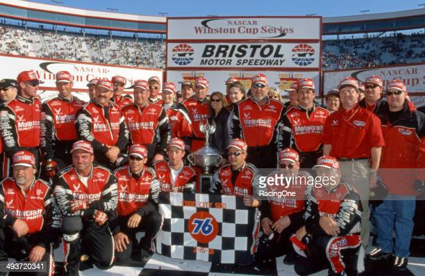 Elliott Sadler and the Wood Brothers team celebrate in victory lane at Bristol Motor Speedway after Sadler won the Food City 500 NASCAR Cup race the...