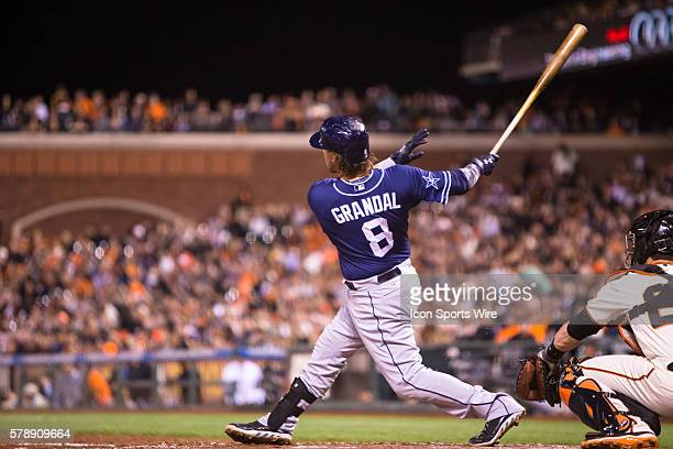 San Diego Padres catcher Yasmani Grandal at bat and following the trajectory of the ball after getting a solo home run int he 6th inning during the...