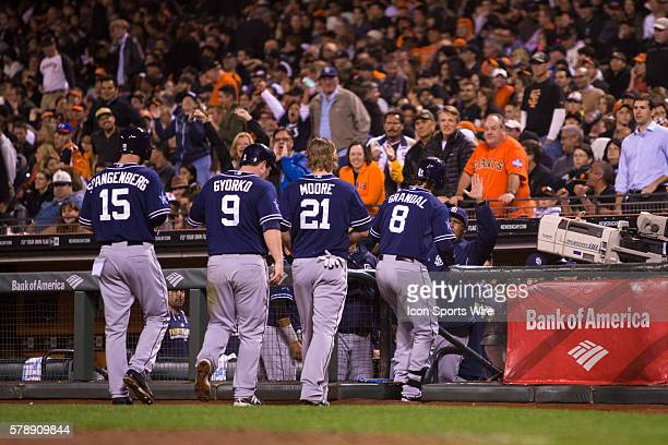 San Diego Padres catcher Yasmani Grandal beds in to the dugout after getting a grand slam in the 7th inning as San Diego Padres right fielder Jeff...