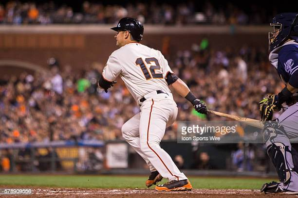 San Francisco Giants second baseman Joe Panik at bat and following the trajectory of the ball after connecting during the game between the San...