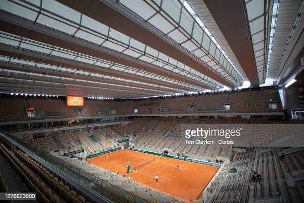 September 25 A general view as Alexander Zverev of Germany plays a practice match against Pablo Carreno Busta on Court PhilippeChatrier with the roof...