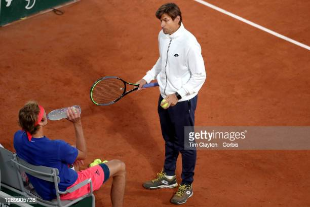 September 25. Coach David Ferrer talks with Alexander Zverev of Germany while playing a practice match against Pablo Carreno Busta on Court...