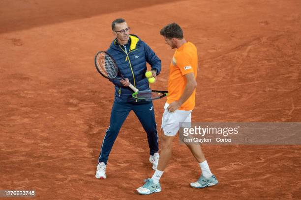September 25 Coach Samuel López Cesar Fábregas talks with Pablo Carreno Busta of Spain while playing a practice match against Alexander Zverev of...
