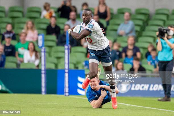 September 25: Madosh Tambwe of the Bulls avoids the tackle of Rory O'Loughlin of Leinster during the Leinster V Bulls, United Rugby Championship...