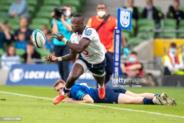 September 25: Madosh Tambwe of the Bulls makes a pass after avoiding the tackle of Rory O'Loughlin of Leinster during the Leinster V Bulls, United...
