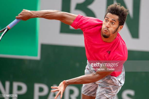 September 25 Michael Mmoh of the United States in action against Renzo Oliver of Argentina during the Qualifications Men's Singles 3rd round match at...