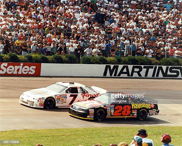 Geoff Bodine tries to hold off Ernie Irvan during the Goody's 500 NASCAR Cup race at Martinsville Speedway Irvan won the pole position and dominated...