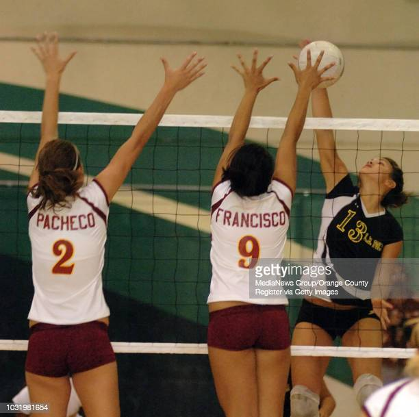 September 26 2006 Wilson High's Amanda Pacheco and Genie Francisco attempt to block a shot from Poly's Jessica Colberg during their game in Long...