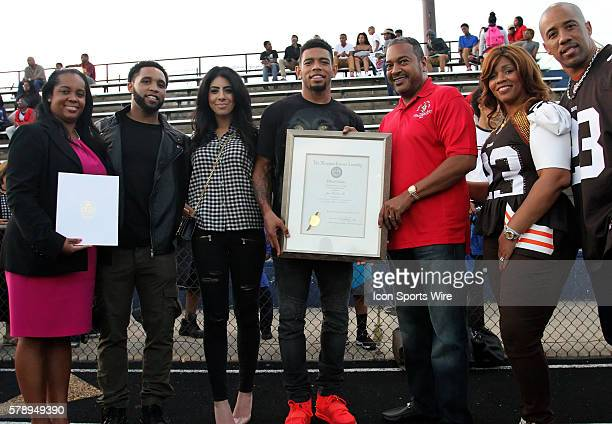 Cleveland Browns cornerback Joe Haden III is honored after donating uniforms and equipment to his alma mater during Joe Haden III day at Friendly...