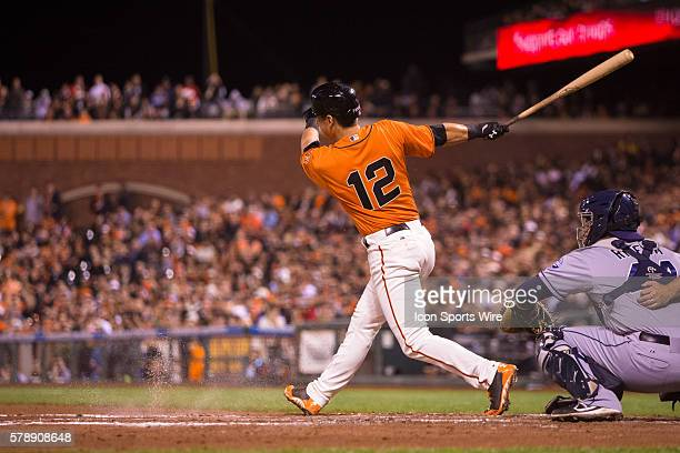 San Francisco Giants second baseman Joe Panik at bat and following the trajectory after connecting during the game between the San Francisco Giants...