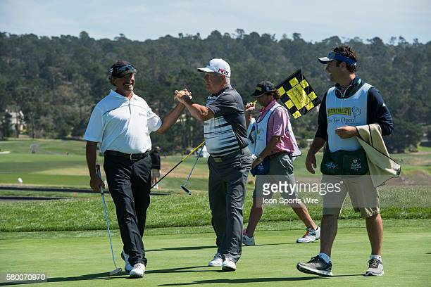 Carlos Franco and amateur L Hurtubise celebrate on six following a successful putt during the second round of the Nature Valley First Tee Open at...