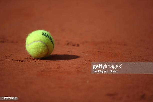 September 26. A Wilson tennis ball, the official tennis ball of the tournament, on the clay surface at the 2020 French Open Tennis Tournament at...