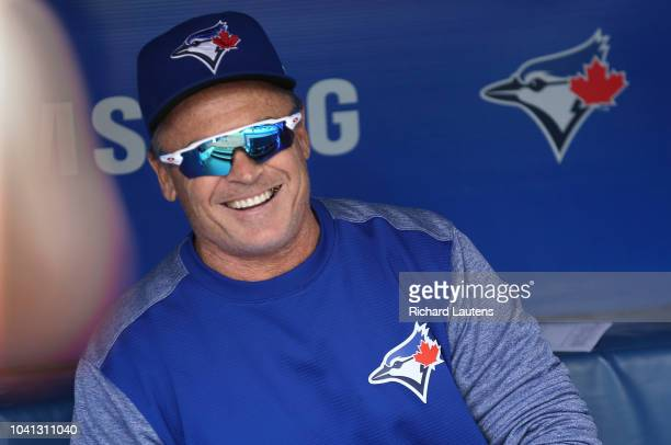 TORONTO ON September 26 Prior to the start of the game Manager John Gibbons waits in the dugout The Toronto Blue Jays took on the Houston Astros in...
