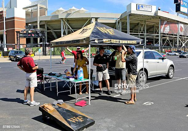 Some Wake Forest and Louisville tailgaters enjoy the atmosphere prior to the game between the Wake Forest Demon Deacons and the Louisville Cardinals...