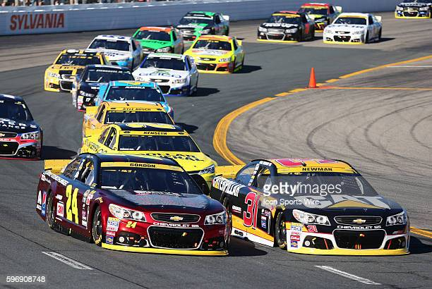 Jeff Gordon Sprint Cup driver of the Drive To End Hunger Chevrolet gets around Ryan Newman Sprint Cup driver of the Catepillar Chevrolet coning out...