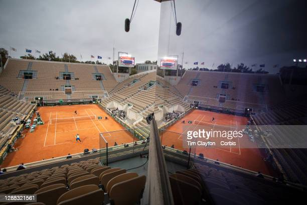 September 27. A general view of the empty Court Suzanne Lenglen reflected in a stadium window as Coco Gauff of the United States plays against...