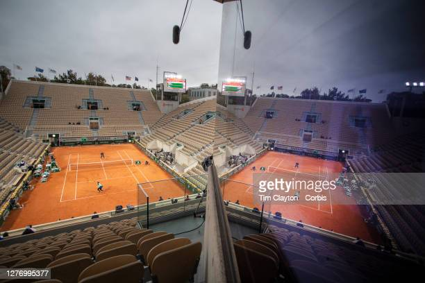 September 27. A general view of the empty CourtSuzanne Lenglen reflected in a stadium window as Coco Gauff of the United States plays against...