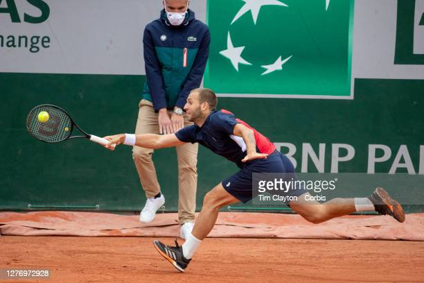 September 27. Daniel Evans of Great Britain in action against Kei Nishikori of Japan on CourtFourteen in the first round of the singles competition...