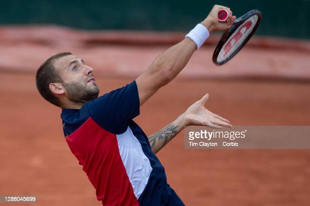 September 27. Daniel Evans of Great Britain in action against Kei Nishikori of Japan on CourtFourteen in the first round of the Men's Singles...