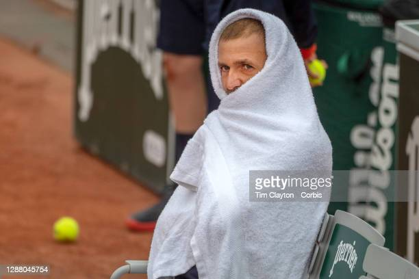 September 27. Daniel Evans of Great Britain keeps warm during a change of ends during his match against Kei Nishikori of Japan on CourtFourteen in...