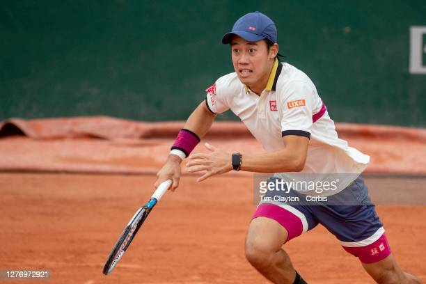 September 27. Kei Nishikori of Japan in action against Daniel Evans of Great Britain on CourtFourteen in the first round of the singles competition...