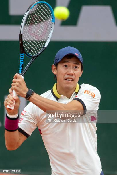 September 27. Kei Nishikori of Japan in action against Daniel Evans of Great Britain on CourtFourteen in the first round of the Men's Singles...