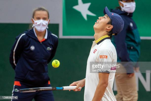 September 27. Kei Nishikori of Japan reacts during his match against Daniel Evans of Great Britain on CourtFourteen in the first round of the Men's...