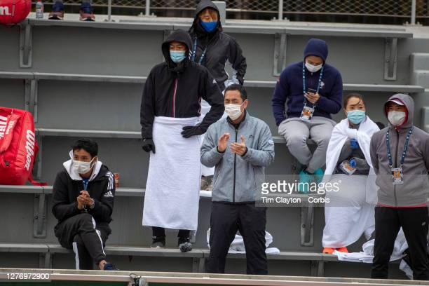 September 27. The team of Kei Nishikori of Japan give their support during his match against Daniel Evans of Great Britain on CourtFourteen in the...