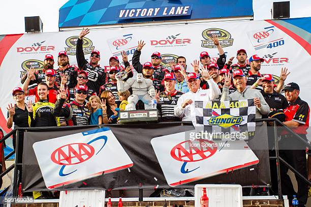 NASCAR Chase contender Jeff Gordon driver of the Drive To End Hunger Chevrolet celebrates in Victory Lane after winning the NASCAR Sprint Cup Series...