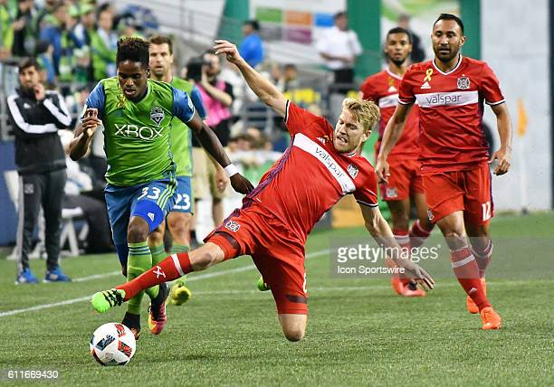 Seattle Sounders FC defender Joevin Jones and Chicago Fire midfielder Micahel de Leeuw battle for the ball during a MLS match between the Seattle...