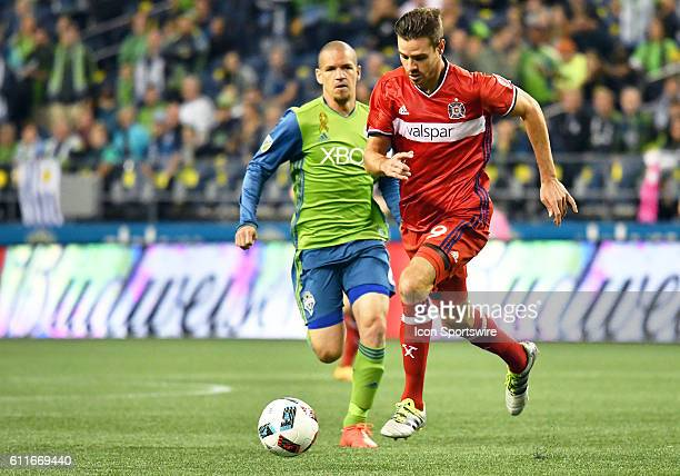 Seattle Sounders FC midfielder Osvaldo Alonso pursues Chicago Fire forward Luis Solignac during a MLS match between the Seattle Sounders FC and...