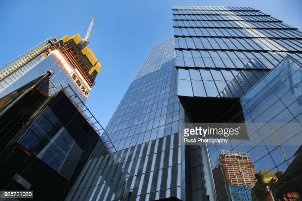 september 28th, 2017: view from below of skyscrapers at the massive 28-acres hudson yards redevelopment site,  located between 30th and 34th street, and 10th and 12th avenue in midtown manhattan, new york city - manhattan new york city stock pictures, royalty-free photos & images