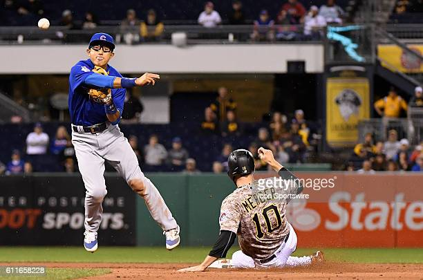 Chicago Cubs shortstop Munenori Kawasaki turns a double player in the third inning during the game between the Pittsburgh Pirates and the Chicago...