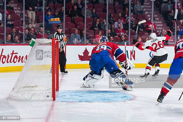 Senators Matt Puempel scores the first goal of the game against Canadiens goalkeeper Mike Condon during the Ottawa Senators versus the Montreal...