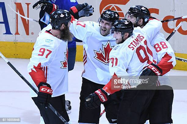 Team Canada Team Mates celebrate a goal during Game 2 of theWCOH best of three finals between Team Europe and Team Canada at Air Canada Centre in...
