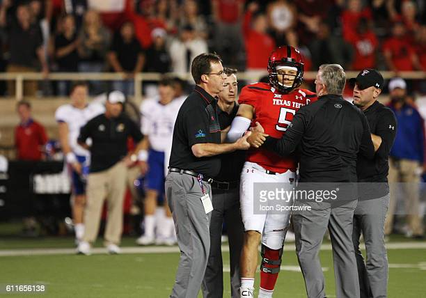 Training staff assist Texas Tech University quarterback Patrick Mahomes II off of the field after he suffered an injury during the Texas Tech...
