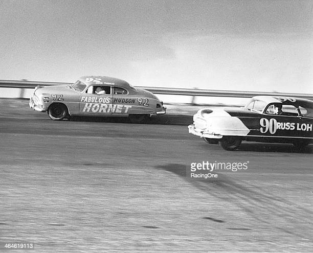 Herb Thomas races his Hudson Hornet past the Nash of Shorty York on his way to winning the Southern 500 NASCAR Cup race at Darlington Raceway just...