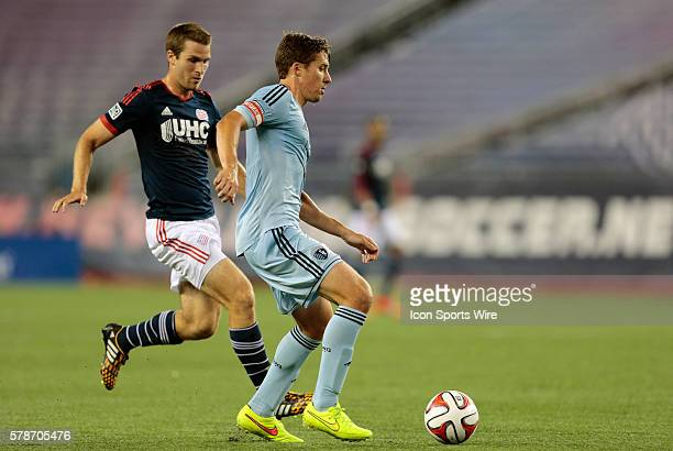 Sporting Kansas City's Matt Besler watched by New England Revolution's Patrick Mullins The New England Revolution defeated Sporting Kansas City 31 in...