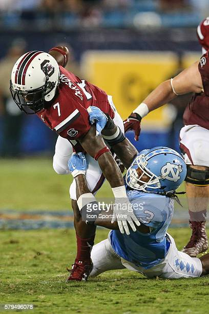 South Carolina Gamecocks running back Shon Carson is brought down by North Carolina Tar Heels safety Sam Smiley during the season opener between the...