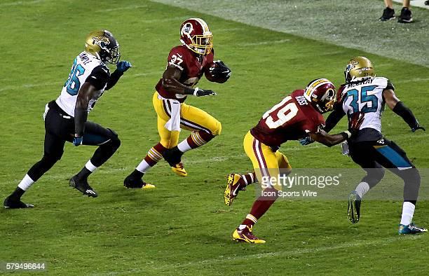 Washington Redskins running back Mack Brown tries to slip past Jacksonville Jaguars cornerback Demetrius McCray during a match between the Washington...
