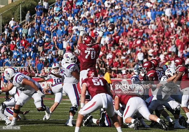 Arkansas Razorbacks offensive lineman Dan Skipper comes close to blocking an extra point during an NCAA football game between the Louisiana Tech...