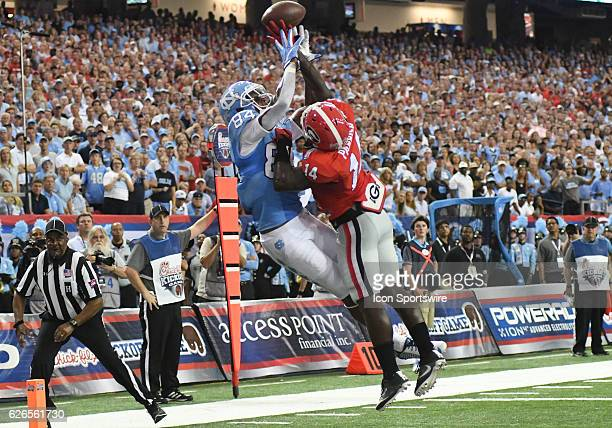 Bug Howard North Carolina Tar Heels wide receiver attempts to catch a pass that is broken up by Malkom Parrish Georgia Bulldogs defensive back during...