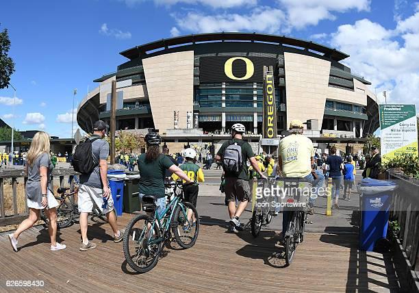 September 3 2016 Fans bike to the stadium during an NCAA football game between the University of Oregon Ducks and UC Davis Aggies at Autzen Stadium...