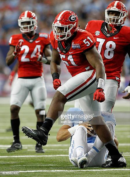 Georgia Bulldogs linebacker David Marshall celebrates after a first half sack during the Chick fil A Kickoff game at the Georgia Dome in Atlanta...