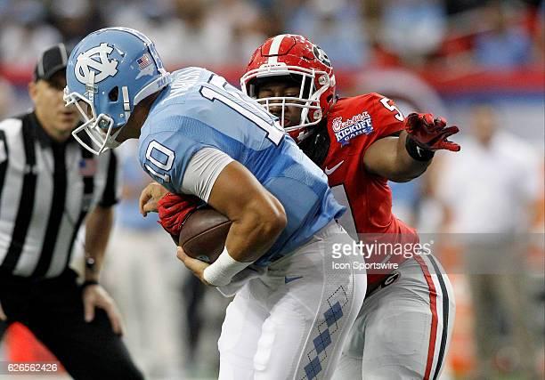 Georgia Bulldogs linebacker David Marshall wraps up North Carolina Tar Heels quarterback Mitch Trubisky for a first half sack during the Chick fil A...